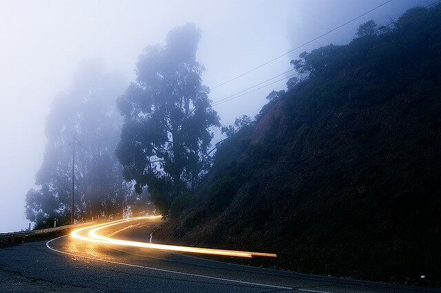 Car headlights on long exposure round a bend