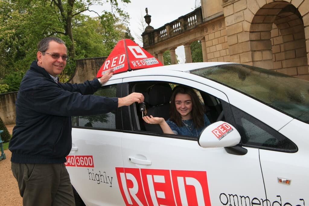 RED driving instructor Dave Childs with learner Maisie Williams