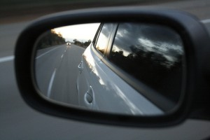 road reflection on car side mirror
