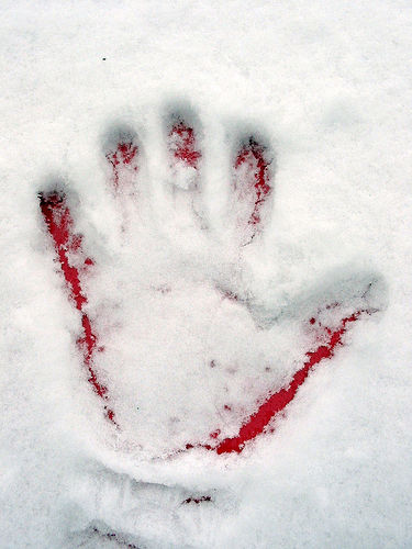 Red handprint in snow