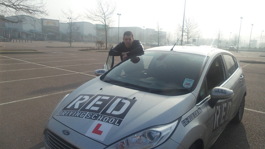 Jay Camilleri with RED driving school car