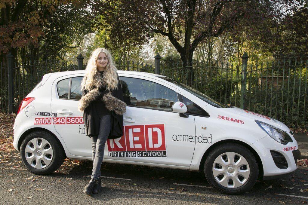 Nina Nesbitt with RED driving school car