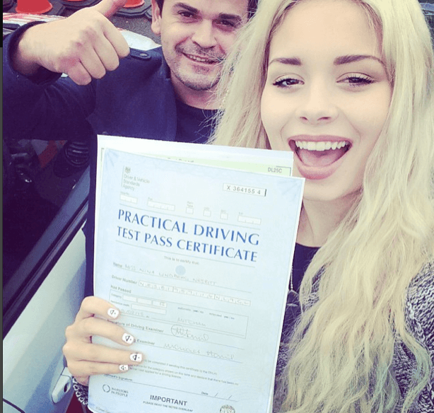 Nina Nesbitt holding practical driving test pass certificate
