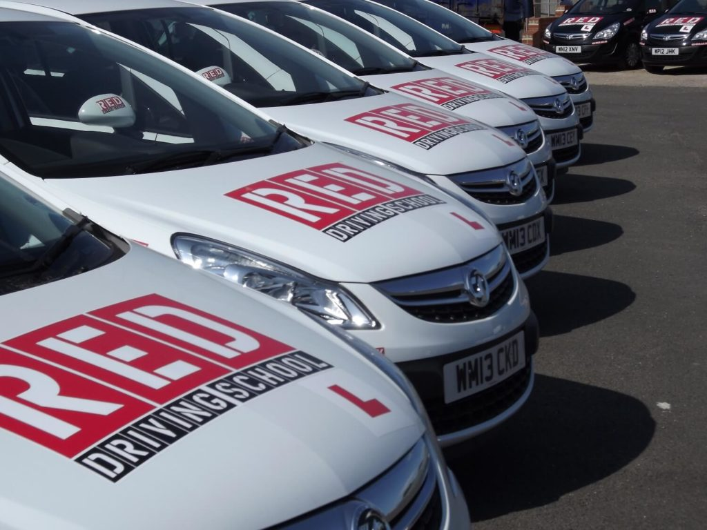 RED Driving school white corsa