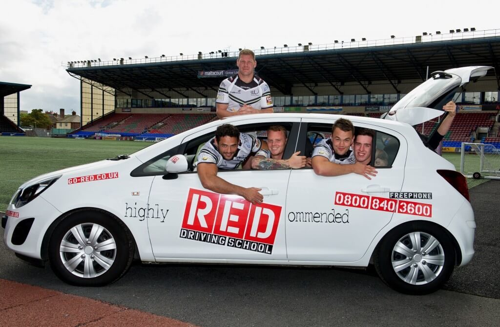 Widness Vikings in RED driving school car