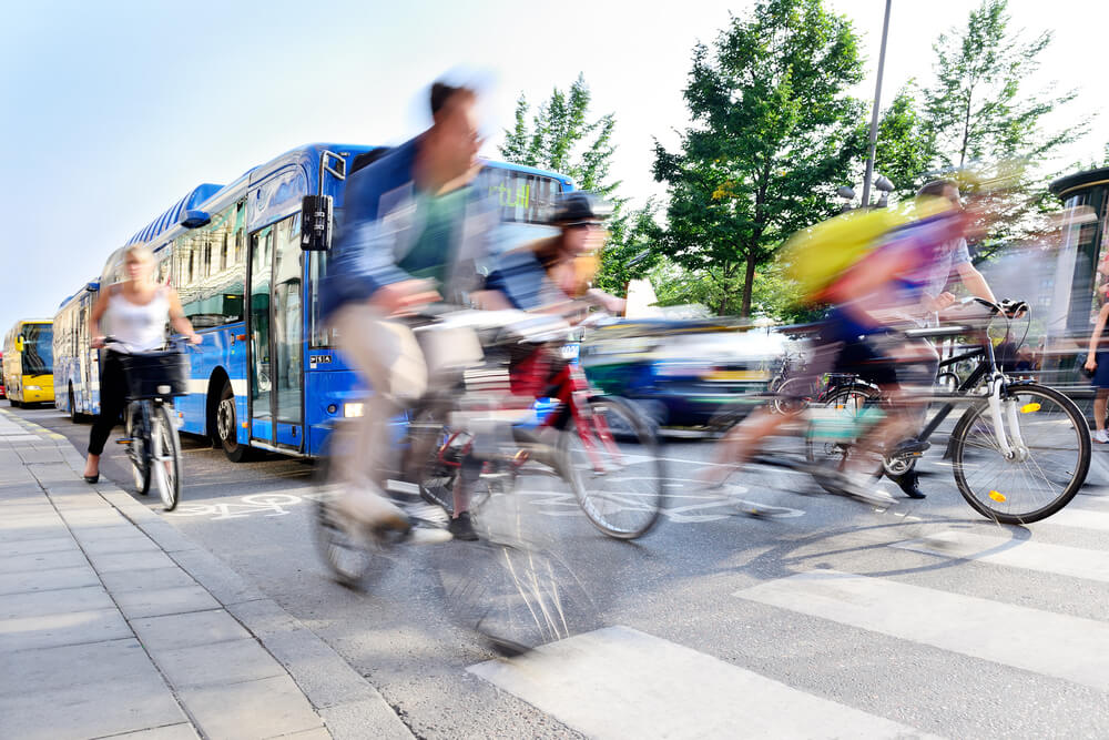 Blurred image of cyclist and bus