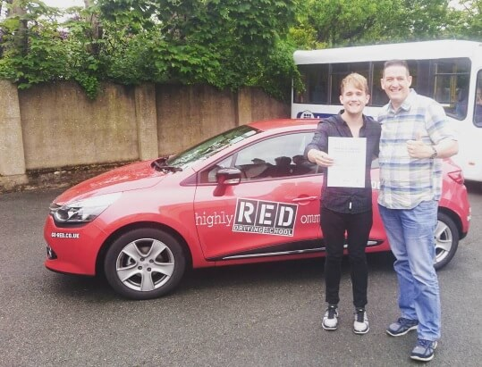 Danny Wilkin with his RED Driving School instructor Dave Bentley and his pass certificate