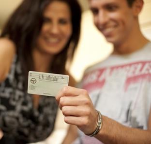 Man and woman looking at a driving license