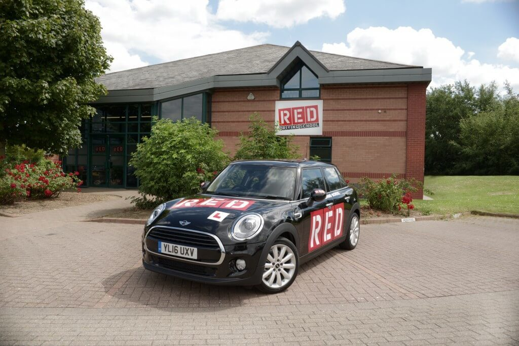RED mini parked outside RED driving school