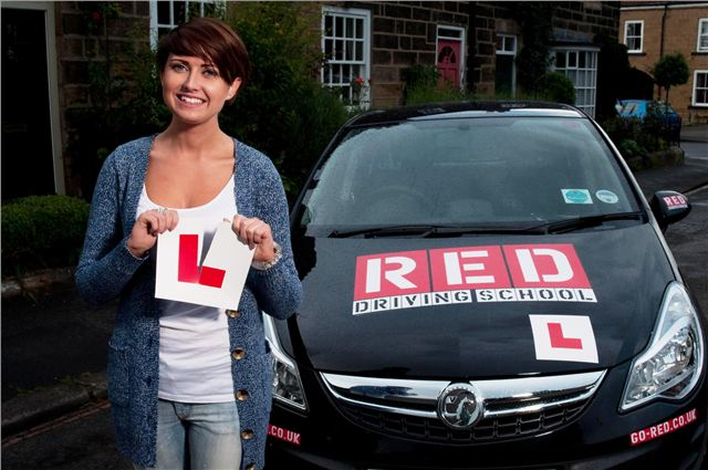 Woman tears up L PLate with RED Driving school car